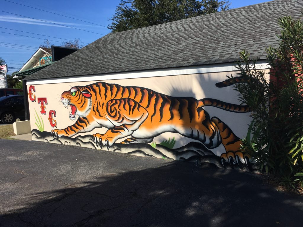 A photo of Mural on the side of the Charleston Tattoo Company on Folly Road.
