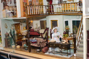 Victorian era decorations in a dollhouse.