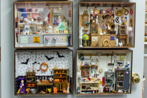 """Roomboxes"" display a variety of miniature decor items available."