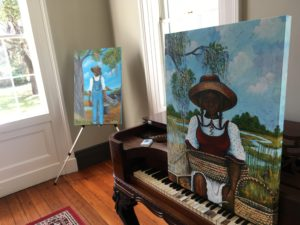 Paintings by Sonja Griffin Evans on display at McLeod Plantation.