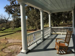 The front porch of the main house at McLeod Plantation.