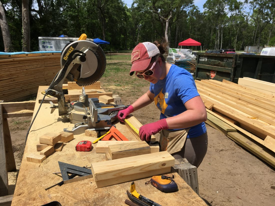Woman working on James Island Habitat for Humanity house
