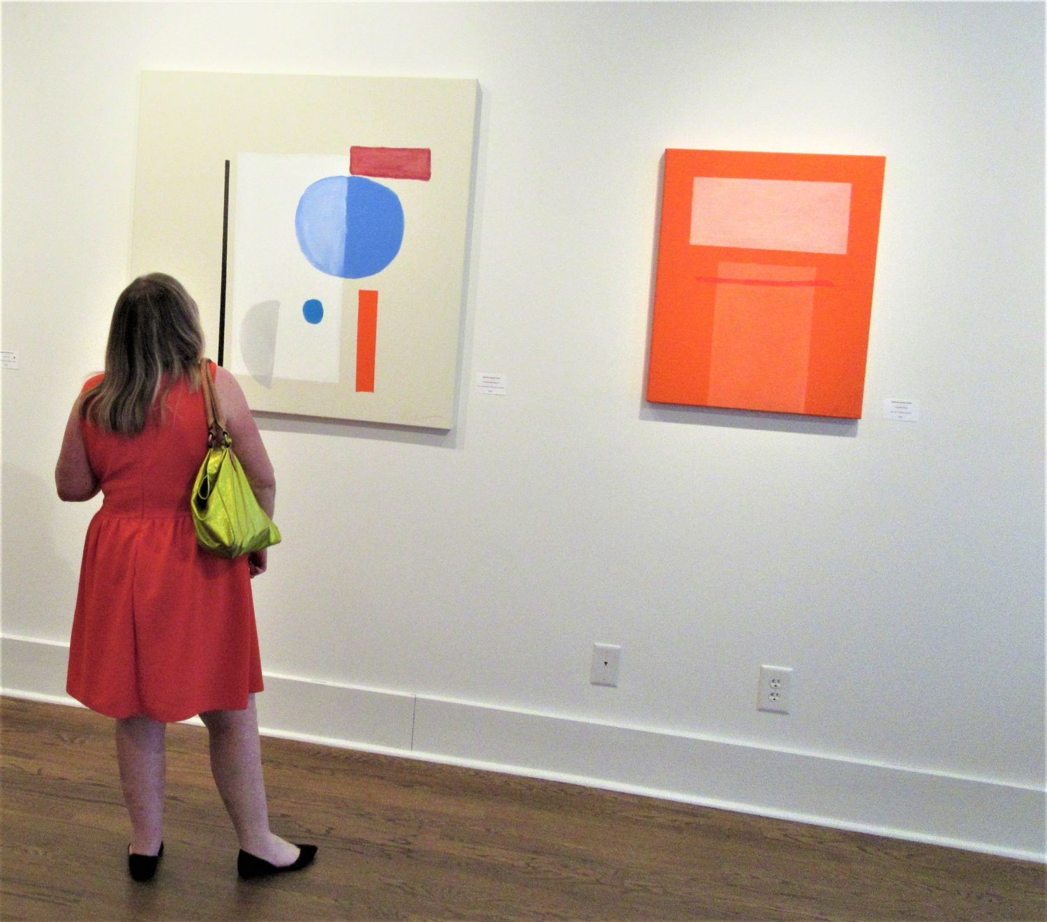 A patron at the George Gallery enjoying the work of Catherine Booker Jones.