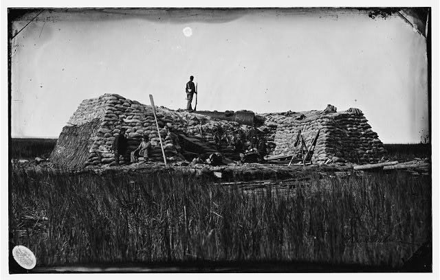 "Morris Island (vicinity), South Carolina. The ""Marsh Battery"" or ""Swamp Angel"" after the explosion, August 22, 1863. From Library of Congress: http://www.loc.gov/pictures/item/cwp2003001659/PP/"