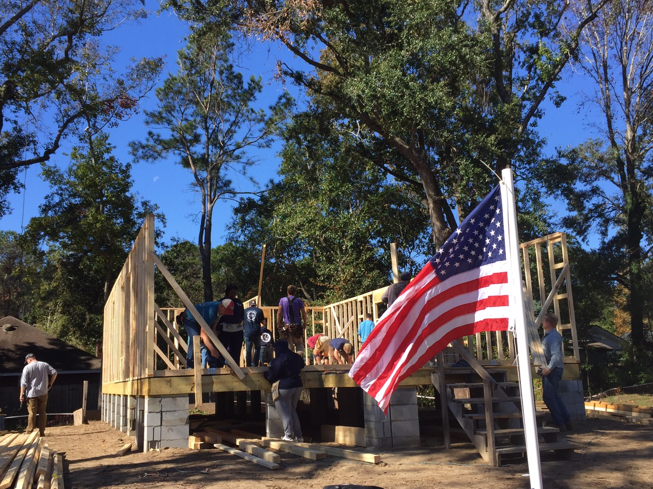 Photo of work site with flag